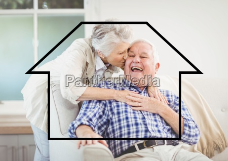 senior woman giving kiss on senior