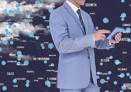 businessman using digital tablet against cloud