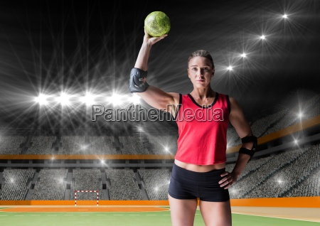 female handball player holding ball at