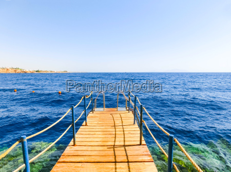 the wooden staircase in the water