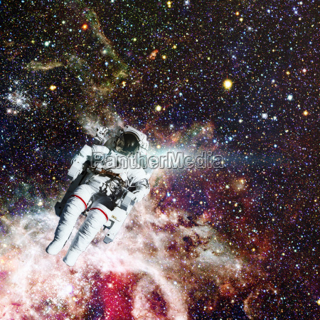 astronaut in outer space nebula on