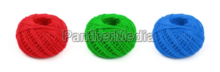 three multicolor twine bobbins isolated on