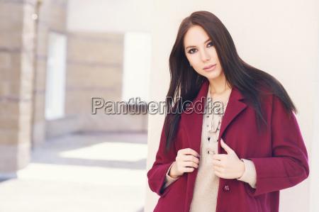 young beautiful stylish woman walking in