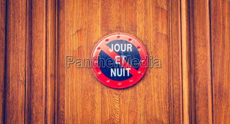 varnished wooden door of a building