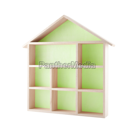 green wooden house shaped shelf isolated