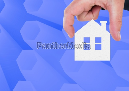 composite image of hand holding house
