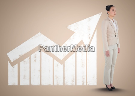 businesswoman standing in front of graph