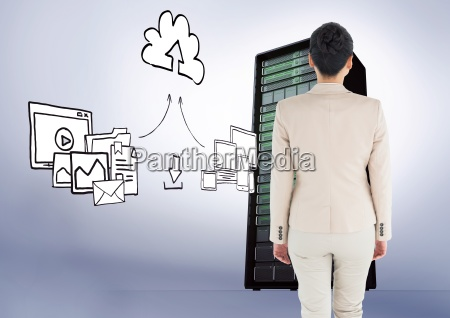 businesswoman standing looking at graphic against
