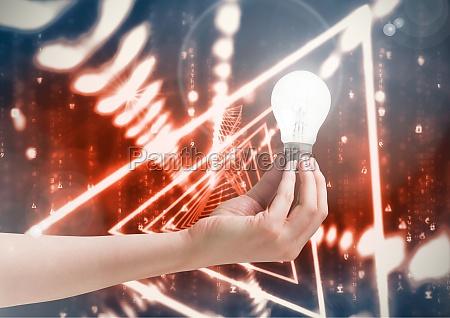 composite image of hand lightbulb glow