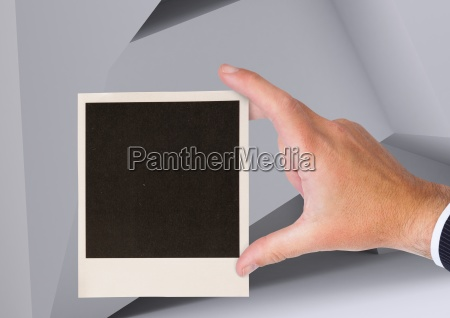 composite image of hand holding polaroid
