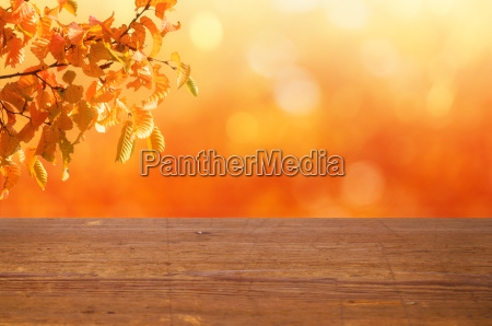 a wooden table with an autumnal