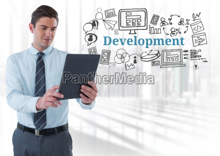 businessman with tablet and development text