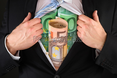 businessman showing question mark symbol