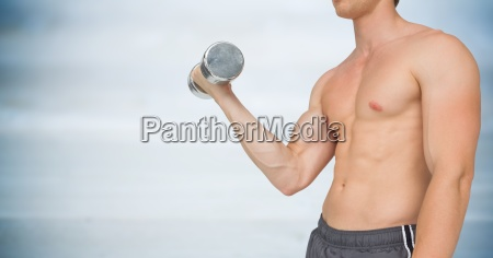 man mid section weightlifting against blurry