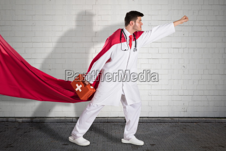 superhero doctor carrying first aid box