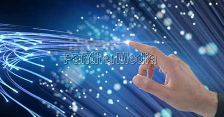 digital composite image of hand touching