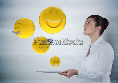 business woman with tablet looking up
