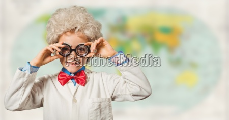 kid scientist against blurry map