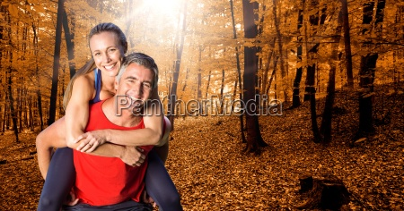 fit man giving piggy back ride
