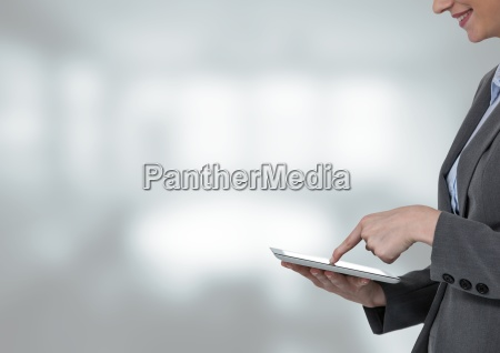woman touching tablet with bright background