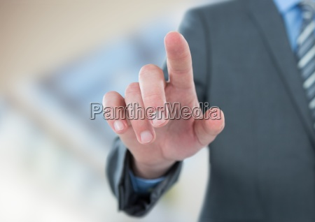 midsection of businessman touching screen