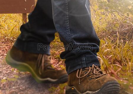 hiking shoes walking in wild rough