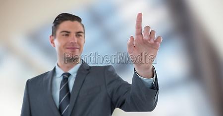 smiling businessman touching screen