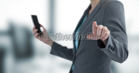 midsection of businesswoman holding mobile phone