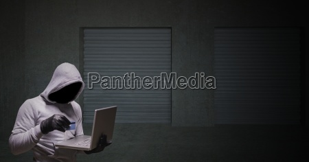 grey jumper hacker with the computer
