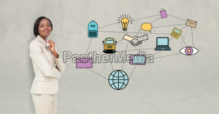businesswoman standing by various icons on