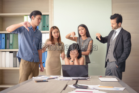 angry team colleague blaming frustrated businesswoman