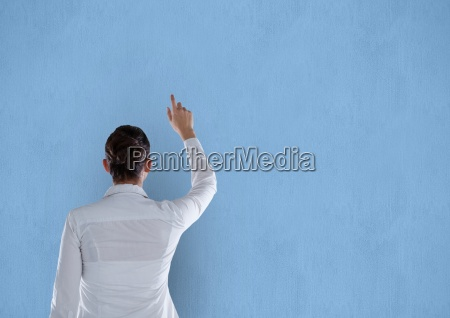 rear view of businesswoman pointing on