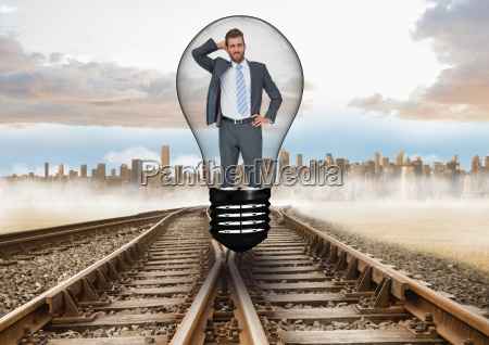 confused businessman in light bulb over
