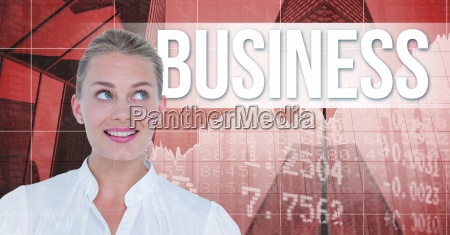 smiling businesswoman looking at business text
