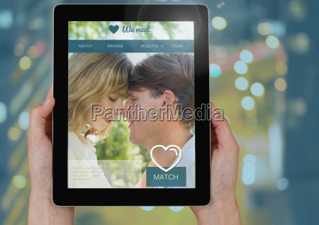 hand holding a tablet with dating