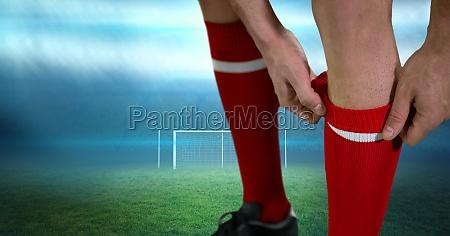 close up of soccer player adjusting