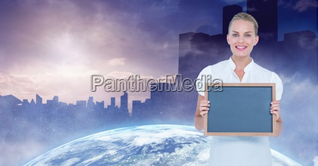 businesswoman holding blank slate with globe