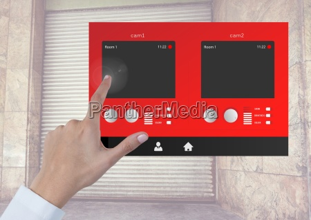 hand touching security camera warehouse app