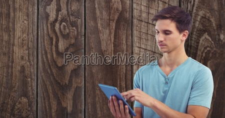 young man using tablet pc against