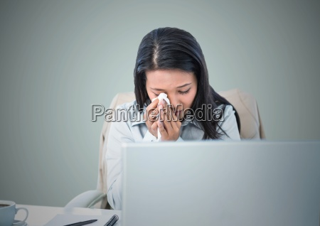 woman crying at computer against light