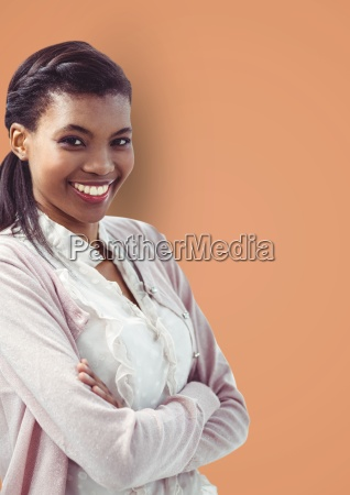 portrait of smiling businesswoman standing arms