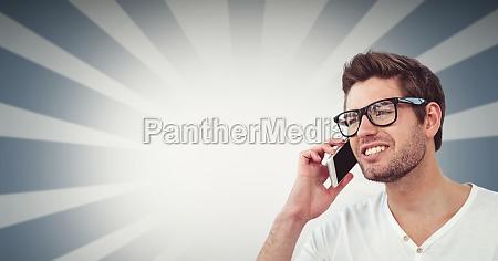 smiling man using smart phone against