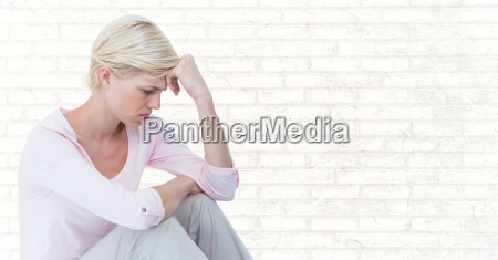 woman sitting with head on hand