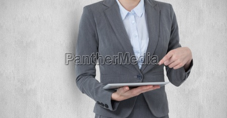 midsection of businesswoman pointing at digital