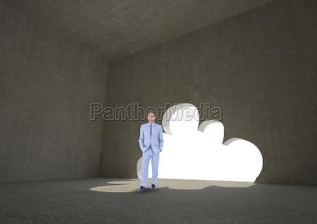 businessman standing by cloud shape doorway