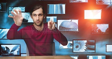 hacker touching transparent screen