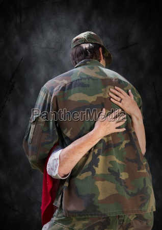 back of soldier being hugged against