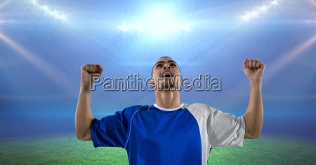soccer player celebrating victory in illuminated