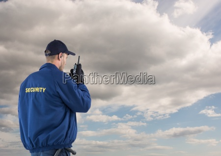 rear view of security guard using