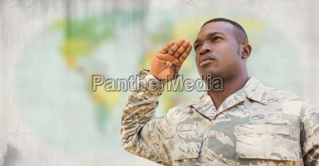 soldier saluting against blurry map with
